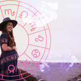 woman in front of birth chart