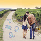 couple in vineyard with astrology symbols around