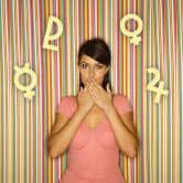 woman holding mouth with astrology symbols around