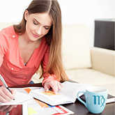 mars in virgo: woman busy working at her desk