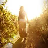 female walking by sun