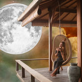 woman relaxing in front of Moon