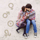 couples embracing with astrology symbols around