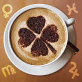 cup of coffee with shamrock and zodiac sign symbols