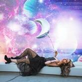 woman with moon balloon