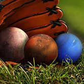 baseball mitt holding planets
