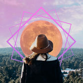 woman in front of pink moon supermoon