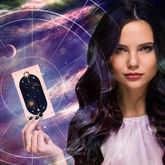 woman holding tarot card