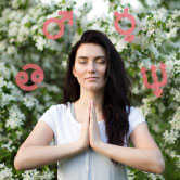 woman meditating with astrology symbols around