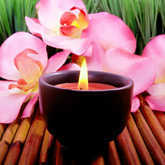 candle with pink orchids