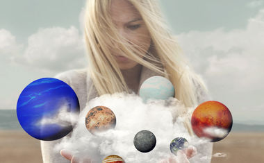 woman holding planets