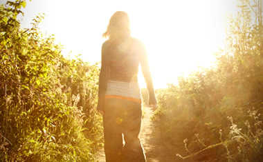 female walking by sun