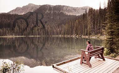 woman at lakefront with mars retrograde symbols