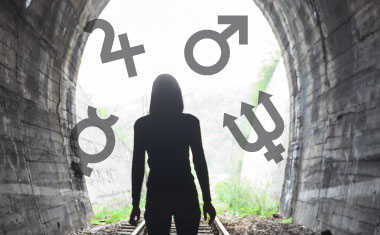 woman in tunnel with astrology symbols around