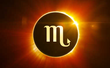 new moon solar eclipse with scorpio symbol