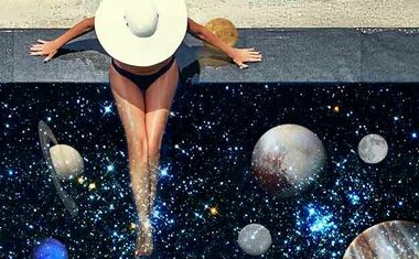 woman looking at planets