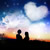 silhouette couple under heart cloud